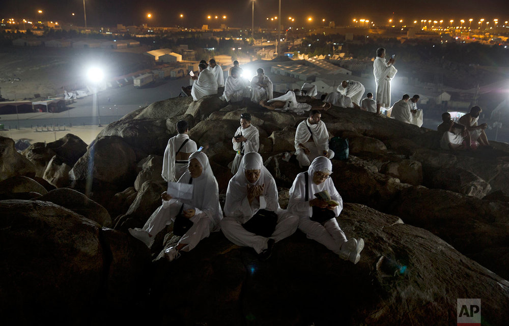 Muslim pilgrims pray on top of the Jabal Al Rahma holy mountain, or the mountain of forgiveness, upon their arrival to Arafat for the annual hajj pilgrimage, outside the holy city of Mecca, Saudi Arabia, Wednesday, Aug. 30, 2017. (AP Photo/Khalil Hamra)