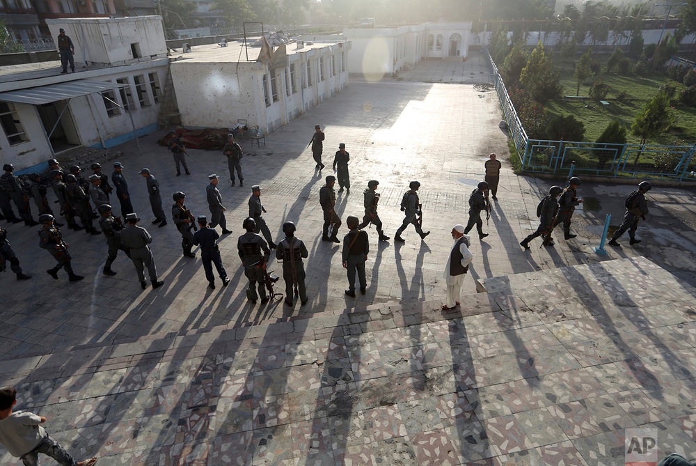 Afghan security police arrive at a Shiite mosque where gunmen attacked during Friday prayers, in Kabul, Afghanistan, Saturday, Aug. 26, 2017. Militants stormed the packed Shiite mosque during Friday prayers in an attack killing worshippers, an official said. (AP Photo/Rahmat Gul)