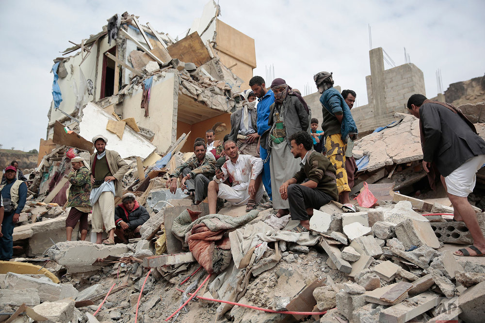 People inspect the rubble of houses destroyed by Saudi-led airstrikes in Sanaa, Yemen, Friday, Aug. 25, 2017. (AP Photo/Hani Mohammed)