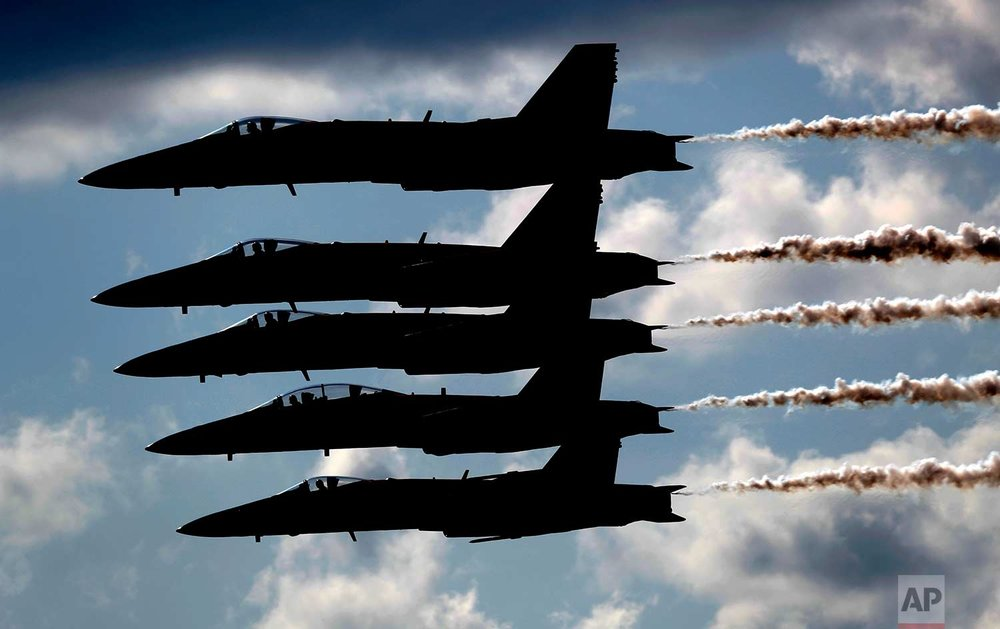 The U.S. Navy Blue Angels demonstration team performs Saturday, Aug. 26, 2017, at the Great State of Maine Air Show at the former Brunswick Naval Air Station, in Brunswick, Maine. (AP Photo/Robert F. Bukaty)