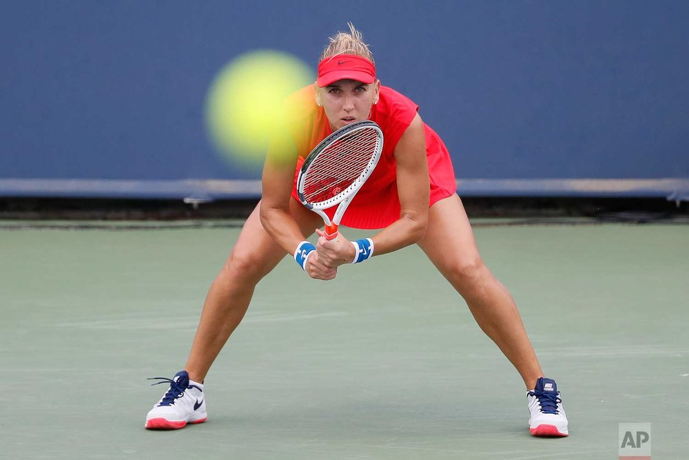 Elena Vesnina, of Russia, waits for a serve from Caroline Wozniacki, of Denmark, during the middle rounds at the Western & Southern Open tennis tournament, Wednesday, Aug. 16, 2017, in Mason, Ohio. (AP Photo/John Minchillo)