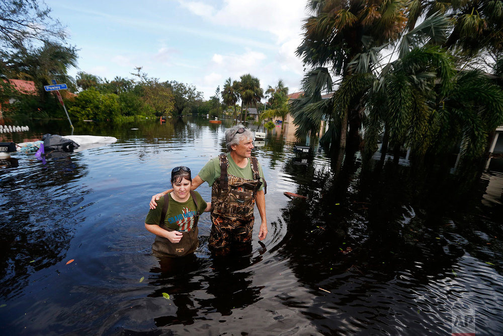 Kelly McClenthen returns to see the flood damage to her home with her boyfriend Daniel Harrison in the aftermath of Hurricane Irma in Bonita Springs, Fla., Monday, Sept. 11, 2017. (AP Photo/Gerald Herbert)