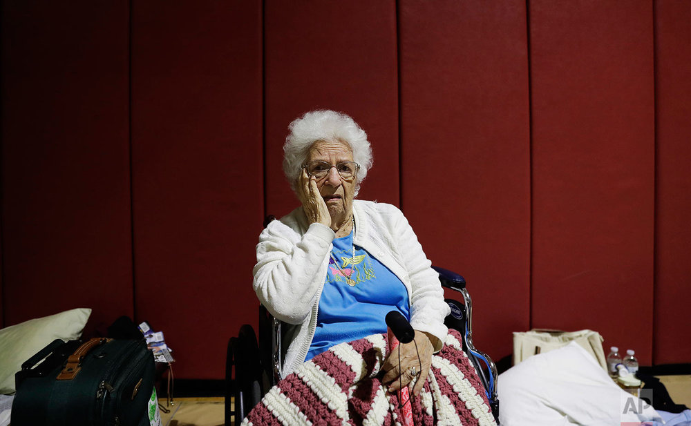 """Mary Della Ratta, 94, sits in shelter after evacuating her home with the help of police last night ahead of Hurricane Irma in Naples, Fla., Sunday, Sept. 10, 2017. """"I'm afraid of what's going to happen. I don't know what I'll find when I go home,"""" said Della Ratta whose husband passed away ten years ago. """"I have nobody. I'm all alone in this world."""" (AP Photo/David Goldman)"""