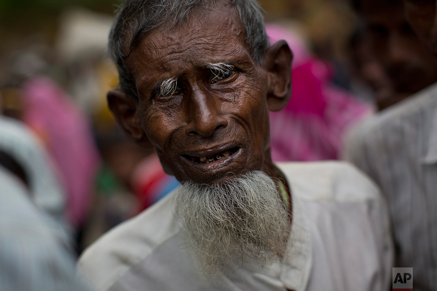 An elderly Rohingya Muslim, who recently crossed over from Myanmar into Bangladesh, arrives at a food distribution center in Kutupalong, Bangladesh, Saturday, Sept. 9, 2017. (AP Photo/Bernat Armangue)