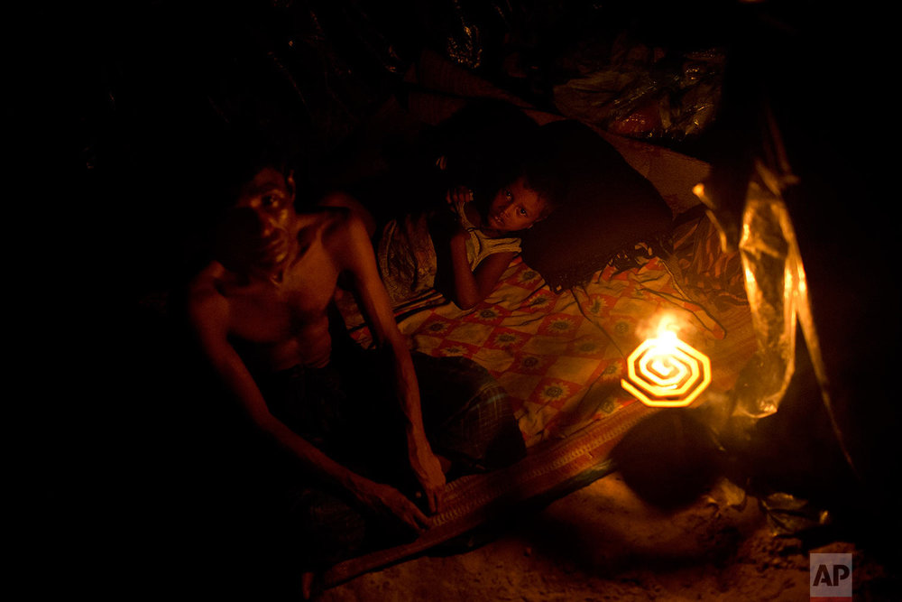 In this Sept. 5, 2017 photo, newly arrived Rohingya rest in a makeshift tent in Kutupalong, Bangladesh. (AP Photo/Bernat Armangue)