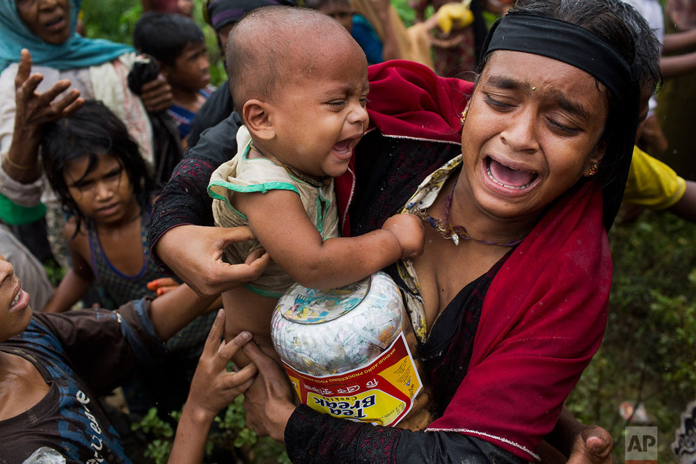 A Rohingya woman breaks down after a fight erupted during food distribution by local volunteers at Kutupalong, Bangladesh, Friday, Sept. 8, 2017. (AP Photo/Bernat Armangue)