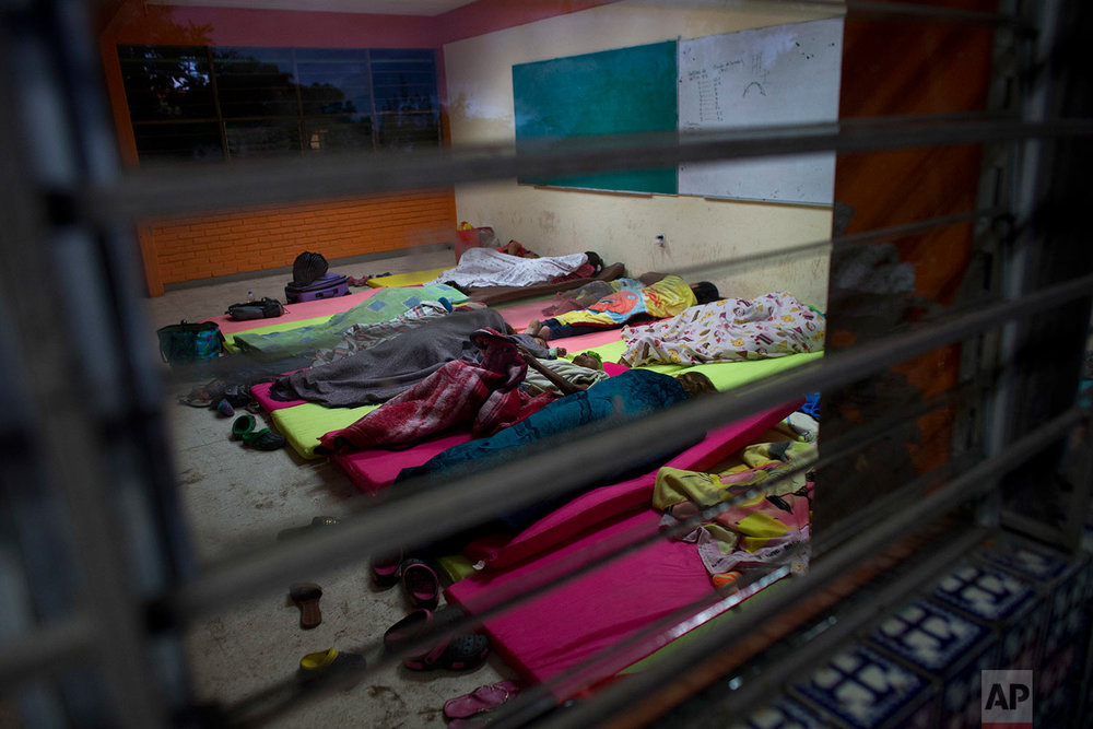 People sleep inside a classroom at a technology school serving as a shelter for residents who fled their destroyed or damaged homes after Thursday's magnitude 8.1 earthquake, in Juchitan, Oaxaca state, Mexico, Monday, Sept. 11, 2017. (AP Photo/Rebecca Blackwell)
