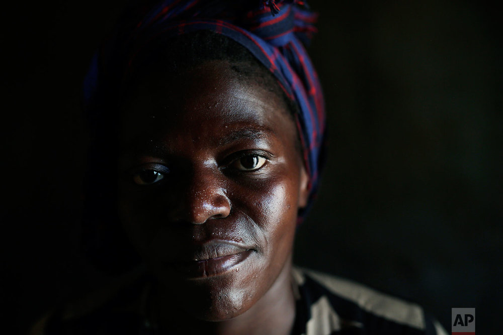 In this photo taken Aug. 10, 2016, Blandine poses for a portrait  in the Congo Ituri province capital Bunia. Blandine said she was raped at age 15 by a Moroccan peacekeeper but has spared her 8-year-old son Michael  the story. Michael has never met his father, and only knows that he was a foreigner from one of the peacekeeping missions in the country.  (AP Photo/Jerome Delay)