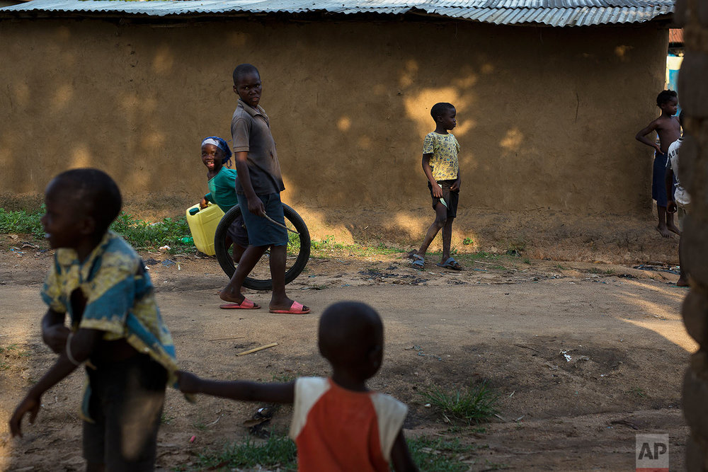 In this photo taken Aug. 10, 2016, children play in the Congo Ituri province capital Bunia. (AP Photo/Jerome Delay)