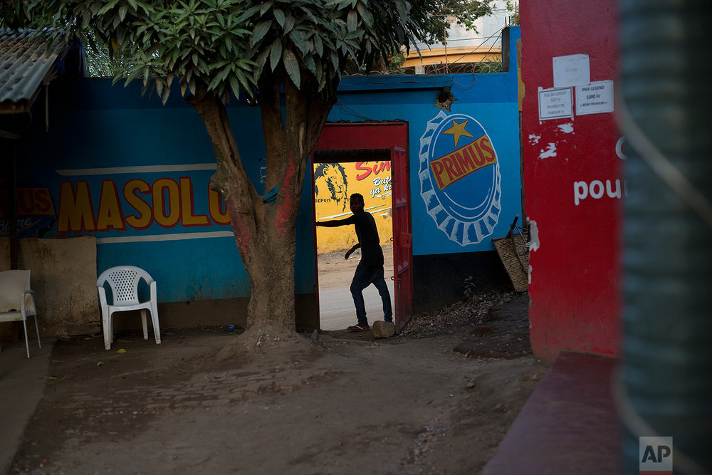 In this photo taken Aug. 10, 2016, a man stands at the entrance of a bar in the Congo Ituri province capital Bunia. Bars and night-clubs are off limits to U.N peacekeepers. (AP Photo/Jerome Delay)