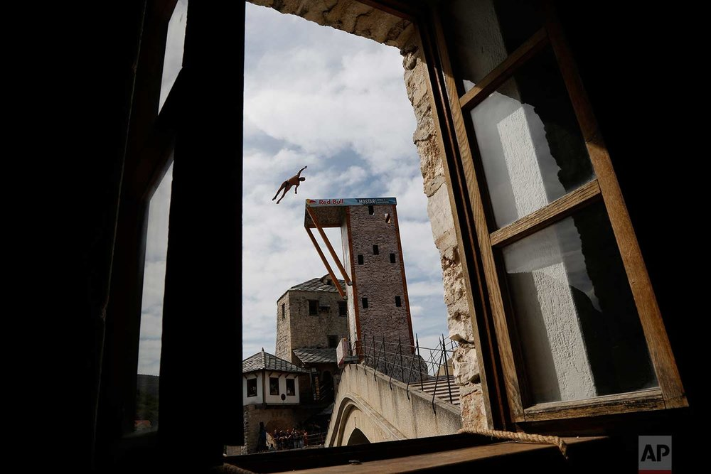 A diver jumps from the Old Mostar Bridge during the Red Bull Cliff Diving World Series 2017, in Mostar, Bosnia-Herzegovina, 140 kilometers south of Sarajevo, Saturday, Sept. 16, 2017. (AP Photo/Amel Emric)
