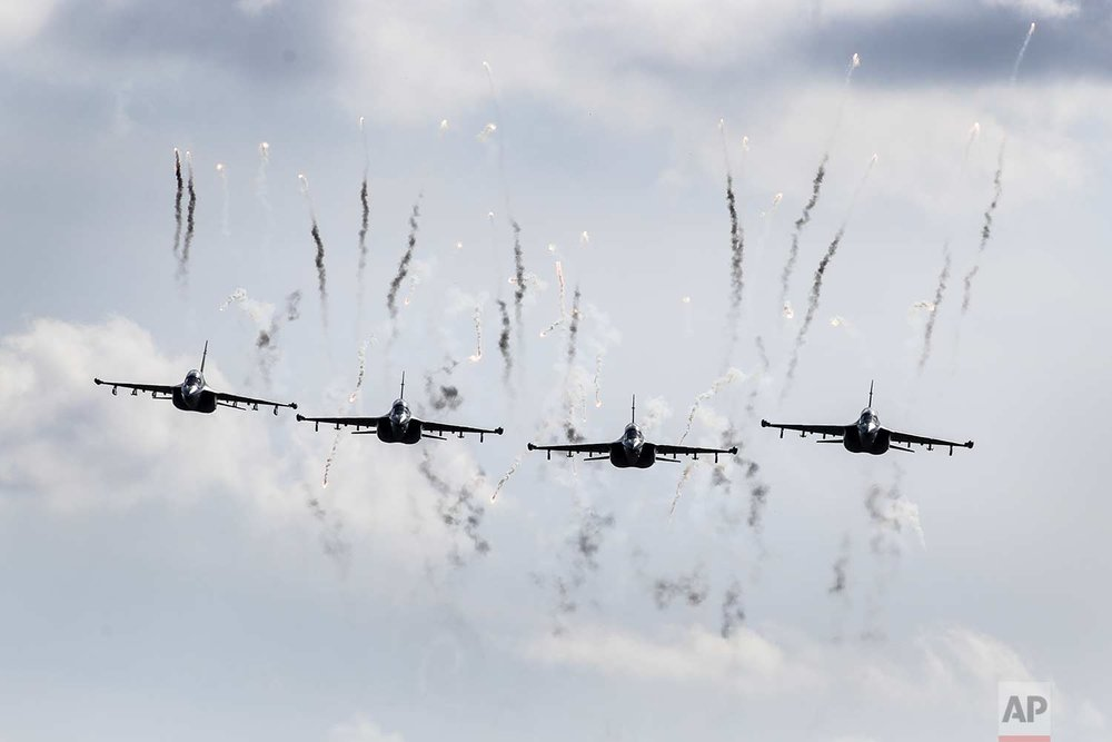 Belarusian military jets fly during military exercises, near the village of Volka, Belarus, 200 kilometers (125 miles) southwest of Minsk on Tuesday, Sept. 19, 2017. The Zapad (West) 2017 military drills held jointly by Russian and Belarusian militaries at several firing ranges in both countries have rattled Russia's neighbors. (AP Photo/Sergei Grits, Pool)