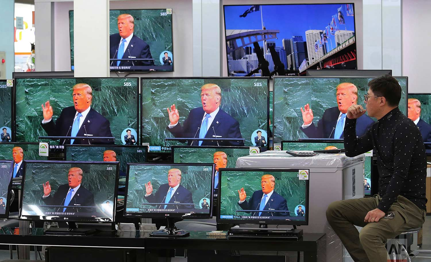 "Television screens show a news program with an image of U.S. President Donald Trump during his address at the U.N. General Assembly, at the Yongsan Electronic Market in Seoul, South Korea, Wednesday, Sept. 20, 2017. On Friday, Sept. 22, 2017. North Korean leader Kim Jong Un lobbed a string of insults at Trump, calling him a ""mentally deranged U.S. dotard"" and hinting at a frightening new weapon test. (AP Photo/Ahn Young-joon)"