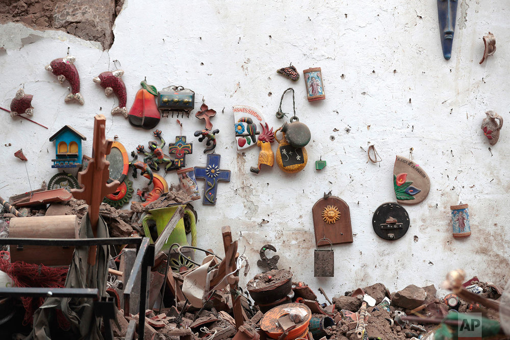 The earthquake damaged wall of a home stands in Tlayacapan, Morelos state, Mexico, Wednesday, Sept. 20, 2017. (AP Photo/Eduardo Verdugo)