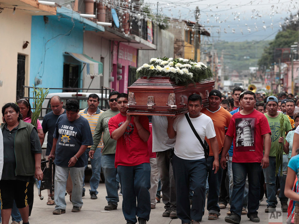 Locals carry the casket of a woman who died in Tuesday's earthquake, in Tlayacapan, Morelos state, Mexico, Wednesday, Sept. 20, 2017.  (AP Photo/Eduardo Verdugo)