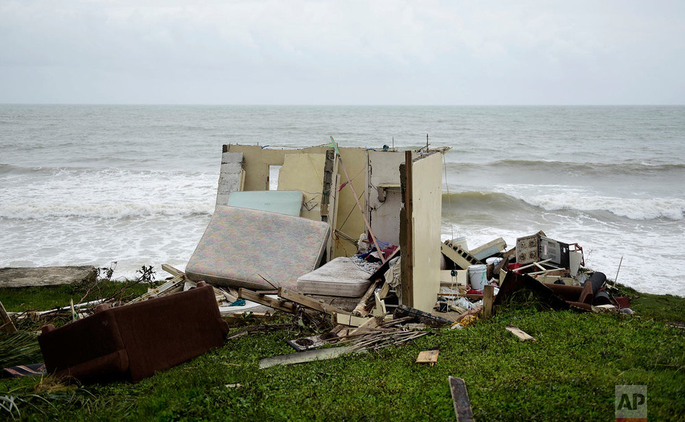 A completely ruined house is seen in El Negro community a day after the impact of Hurricane Maria, in Puerto Rico, Thursday, September 21, 2017.  (AP Photo/Carlos Giusti)