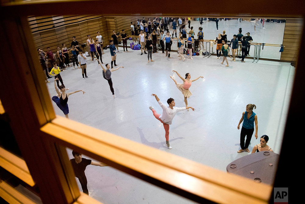 In this Friday, Sept. 15, 2017 photo, dancers take a class with Spain's ballet master Africa Guzman, second from right, in Montevideo, Uruguay. (AP Photo/Matilde Campodonico)