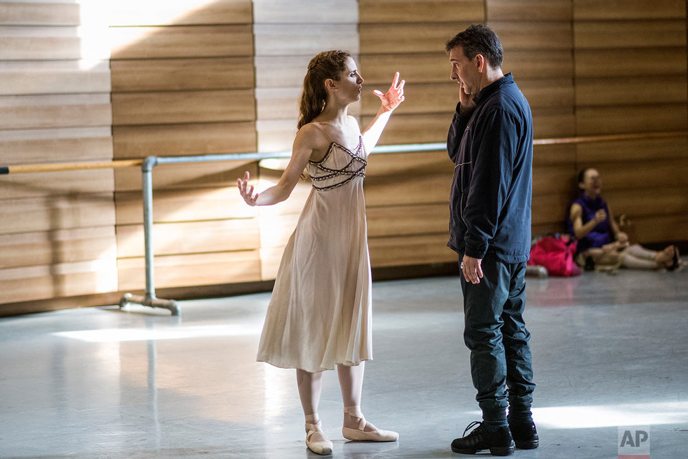 In this Tuesday, Sept. 12, 2017 photo, Director Julio Bocca instructs principal ballet dancer Maria Noel Riccetto during rehearsal for Romeo and Juliet in Montevideo, Uruguay. (AP Photo/Matilde Campodonico)