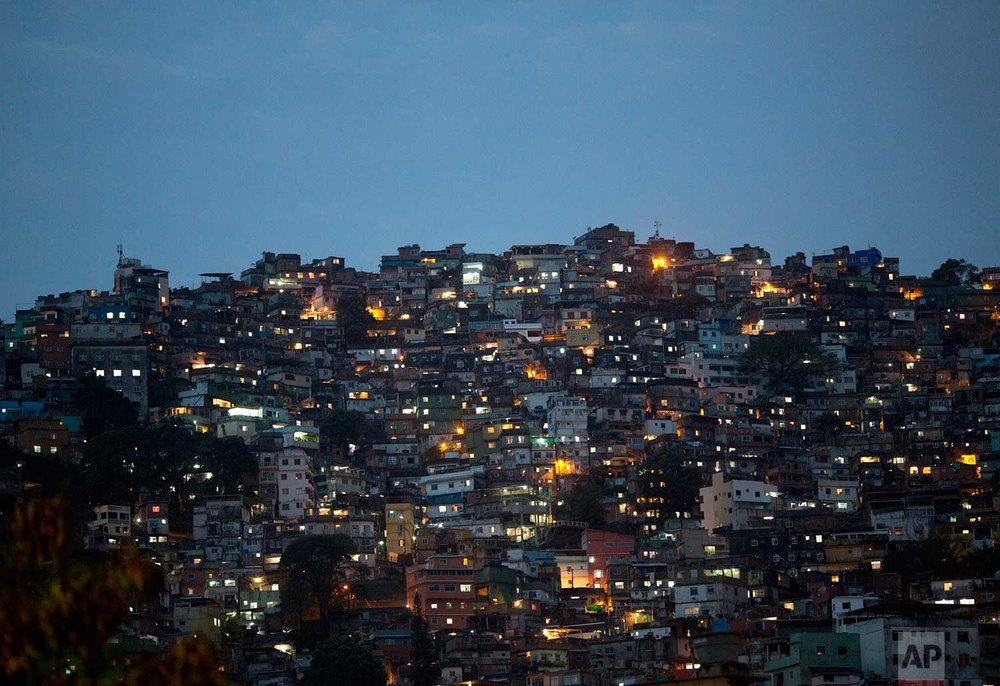 "This Sept. 28, 2017 photo shows a view of the Rocinha shantytown, in Rio de Janeiro, Brazil. Rocinha attracts a lot of attention from authorities as Rio's largest ""favela,"" or slum, and because it borders several upscale neighborhoods. (AP Photo/Silvia Izquierdo)"