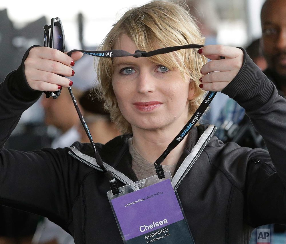 Chelsea Manning puts on a name tag before an appearance at a forum Sunday, Sept. 17, 2017, in Nantucket, Mass. The appearance at the forum is part of The Nantucket Project's annual gathering on the island of Nantucket. Manning is a former U.S. Army intelligence analyst who spent time in prison for sharing classified documents. (AP Photo/Steven Senne)