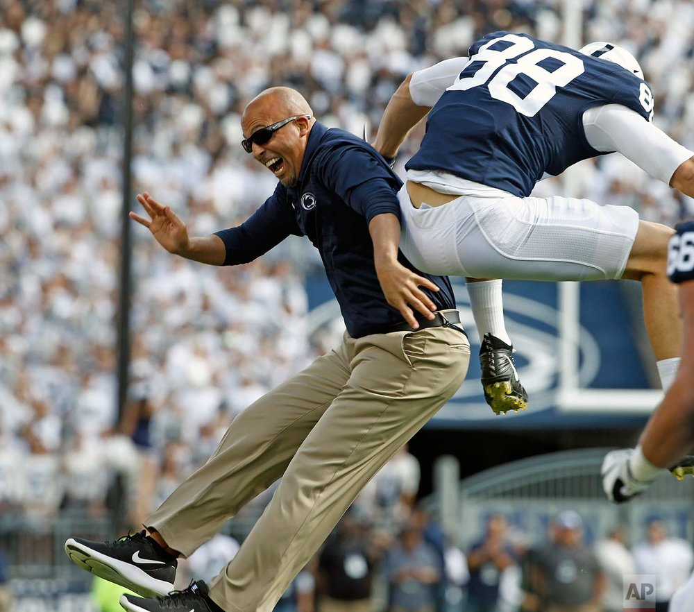 Penn State head coach James Franklin, left, celebrates with tight end Mike Gesicki (88) after Gesicki scored a touchdown against Pittsburgh during the first half of an NCAA college football game in State College, Pa., Saturday, Sept. 9, 2017. (AP Photo/Chris Knight)