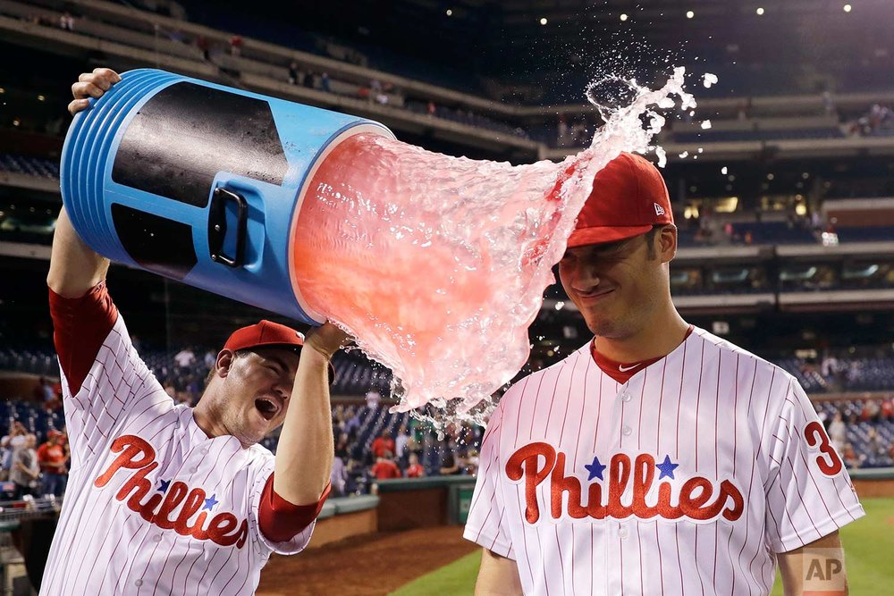 Philadelphia Phillies' Cameron Perkins, right, is doused by Tommy Joseph after a baseball game against the Miami Marlins, Thursday, Sept. 14, 2017, in Philadelphia. Philadelphia won 10-0. (AP Photo/Matt Slocum)