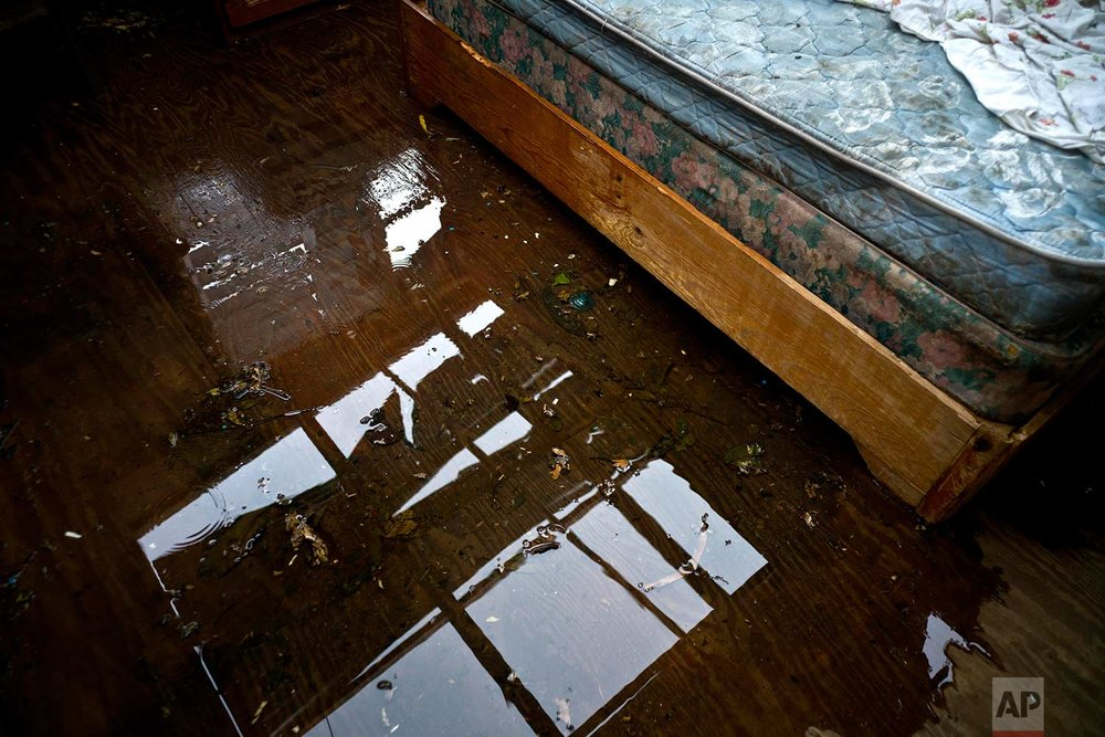 A soaked bed sits in a roam damaged by the passage of hurricane Maria in the San Lorenzo neighborhood of Morovis, Puerto Rico, Saturday, Sept. 30, 2017. (AP Photo/Ramon Espinosa)