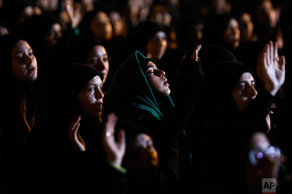 Hezbollah supporters listen to the story of Imam Hussein during activities to mark the ninth of Ashoura, a 10-day ritual commemorating the death of Imam Hussein, in a southern suburb of Beirut, Lebanon, Saturday, Sept. 30, 2017. (AP Photo/Hassan Ammar)