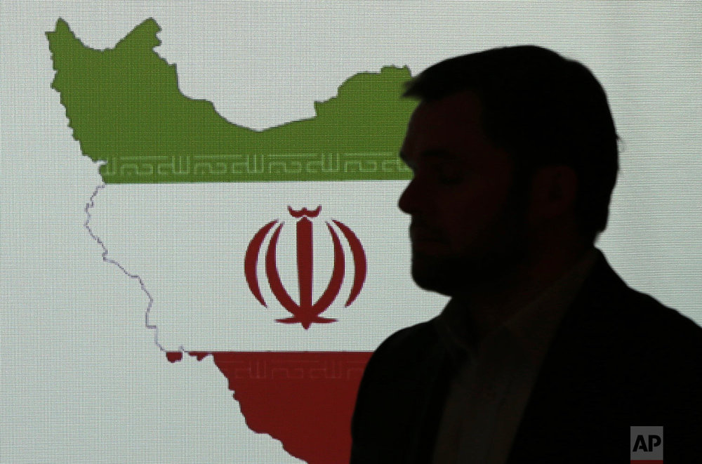 Stuart Davis, a director at one of FireEye's subsidiaries, stands in front of a map of Iran as he speaks to journalists about the techniques of Iranian hacking, Wednesday, Sept. 20, 2017, in Dubai, United Arab Emirates. (AP Photo/Kamran Jebreili)