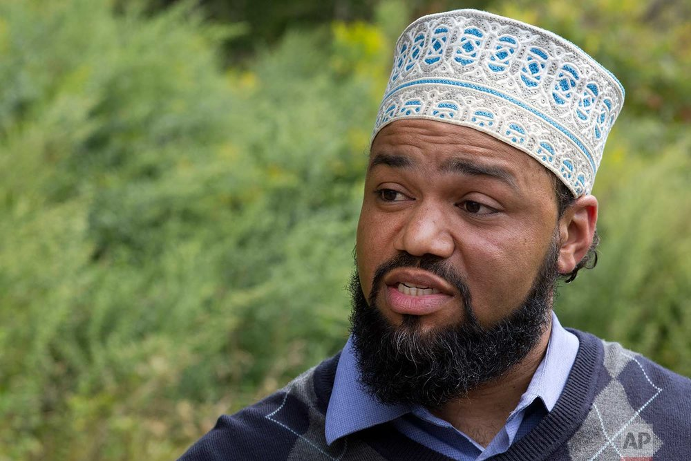 In this Sept. 7, 2017 photo, Hussein Adams, chief executive of The Muslims of America, talks during an interview at Islamberg in Tompkins, N.Y. (AP Photo/Mark Lennihan)