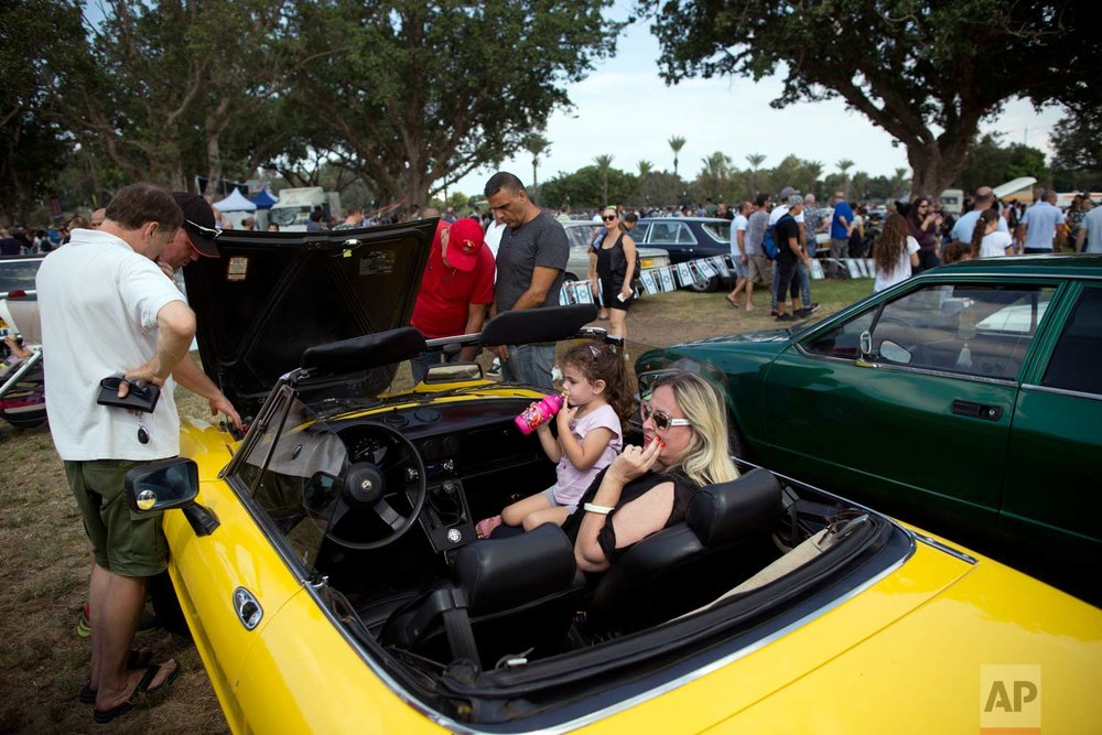 "People look at antique cars during the 31st annual ""Five Club"" collectors car meeting in Ramat Gan, Israel, Friday, Oct. 6, 2017. (AP Photo/Oded Balilty)"