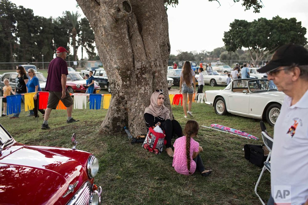 "People look at antique cars during the 31st annual ""Five Club"" collectors cars meeting in Ramat Gan, Israel, Friday, Oct. 6, 2017. (AP Photo/Oded Balilty)"