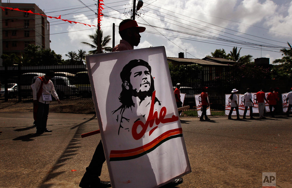 Activists of Sri Lanka's Marxist political party, People's Liberation Front carry posters of Che Guevara during a street march to celebrate international Labor Day known as May Day in Colombo, Sri Lanka, Tuesday, May 1, 2012.  (AP Photo/Gemunu Amarasinghe)