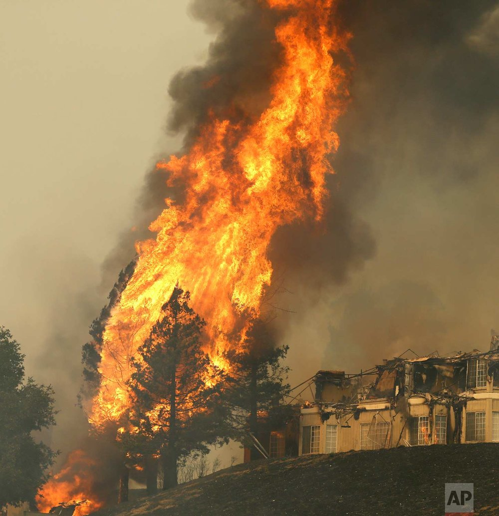Fire continues to rage at the Hilton hotel on Monday, Oct. 9, 2017, in Santa Rosa, Calif. (AP Photo/Ben Margot)