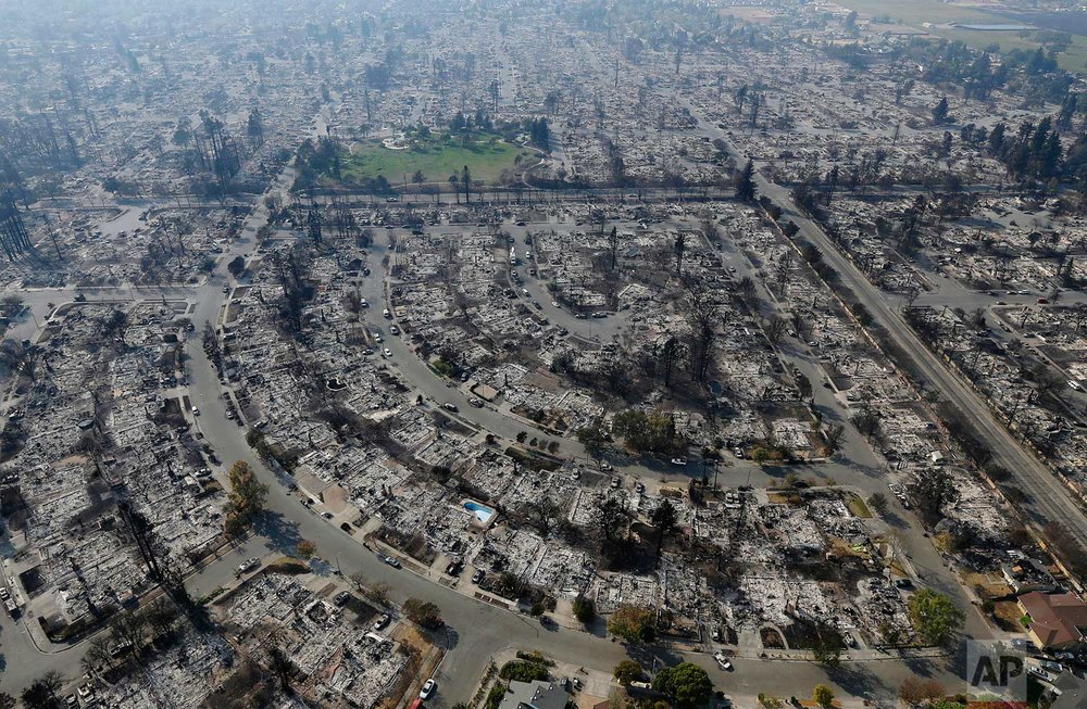 Homes burned by a wildfire are seen Wednesday, Oct. 11, 2017, in Santa Rosa, Calif. (AP Photo/Jeff Chiu)