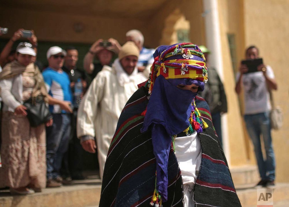 In this Saturday, Sept. 23, 2017 photo, a a bride who marriage was to be legalized during the annual festival of Imilchil, a small village in Morocco's Atlas mountains. (AP Photo/Mosa'ab Elshamy)
