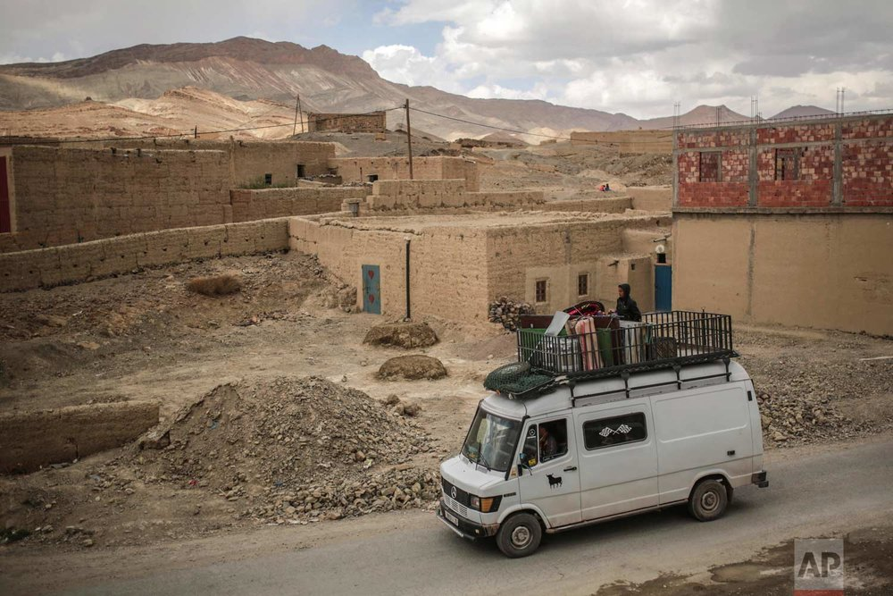 In this Saturday, Sept. 23, 2017 photo, a family drives home after buying good from the annual festival of Imilchil, a small village in Morocco's Atlas Mountains. (AP Photo/Mosa'ab Elshamy)