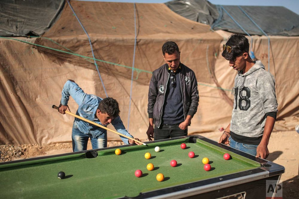 In this Saturday, Sept. 23, 2017 photo, young men play pool at the annual festival of Imilchil, a small village in Morocco's Atlas mountains. (AP Photo/Mosa'ab Elshamy)