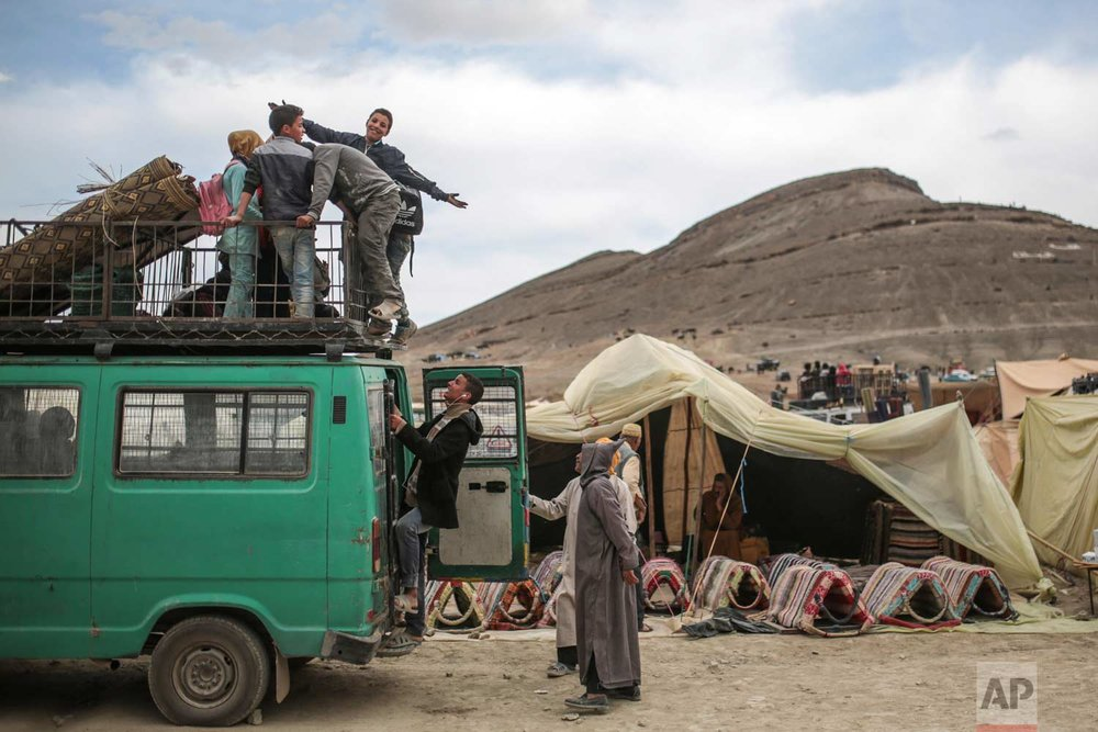 In this Friday, Sept. 22, 2017 photo, a family prepares their truck before leaving the annual festival of Imilchil, a small village in Morocco's Atlas Mountains. (AP Photo/Mosa'ab Elshamy)