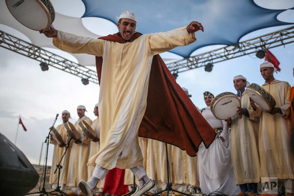 In this Friday, Sept. 22, 2017 photo, a band plays traditional music to attendees of the annual festival of Imilchil, that takes place in a small village in Morocco's Atlas mountains. (AP Photo/Mosa'ab Elshamy)