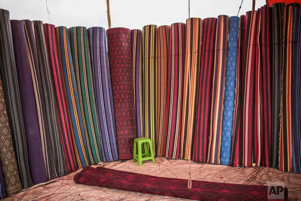 In this Friday, Sept. 22, 2017 photo, colorful rugs are put on display for sale at the annual festival of Imilchil, a small village in the Atlas mountains in Morocco. (AP Photo/Mosa'ab Elshamy)