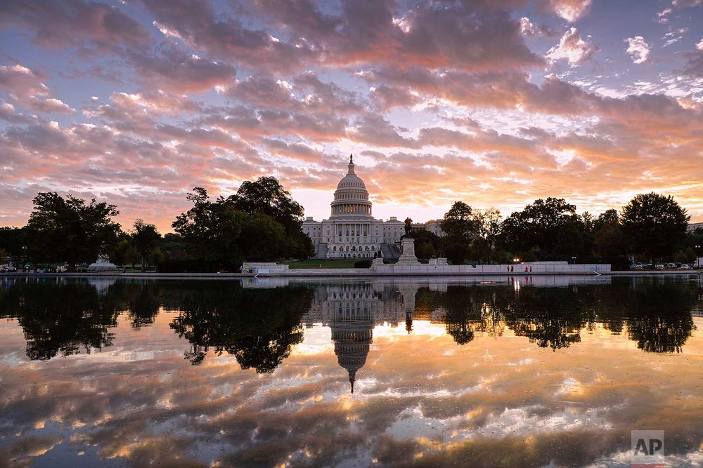 The sun rises above the U.S. Capitol building in Washington on Tuesday, Oct. 10, 2017. (AP Photo/J. Scott Applewhite)