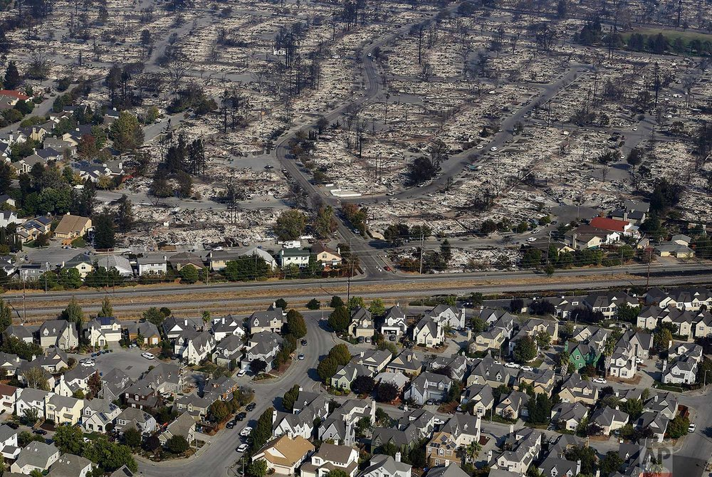 Homes destroyed by fire are seen in an aerial view in Santa Rosa, Calif., on Wednesday, Oct. 11, 2017. (AP Photo/Jeff Chiu)