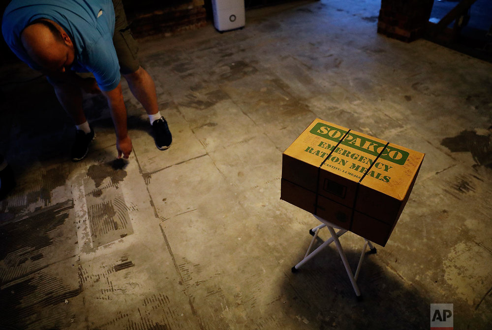 A box of emergency ration meals sits on what used to be the kitchen floor as Wilton Johnson works in his gutted home in Beaumont, Texas, Monday, Sept. 25, 2017, damaged by Hurricane Harvey. (AP Photo/David Goldman)