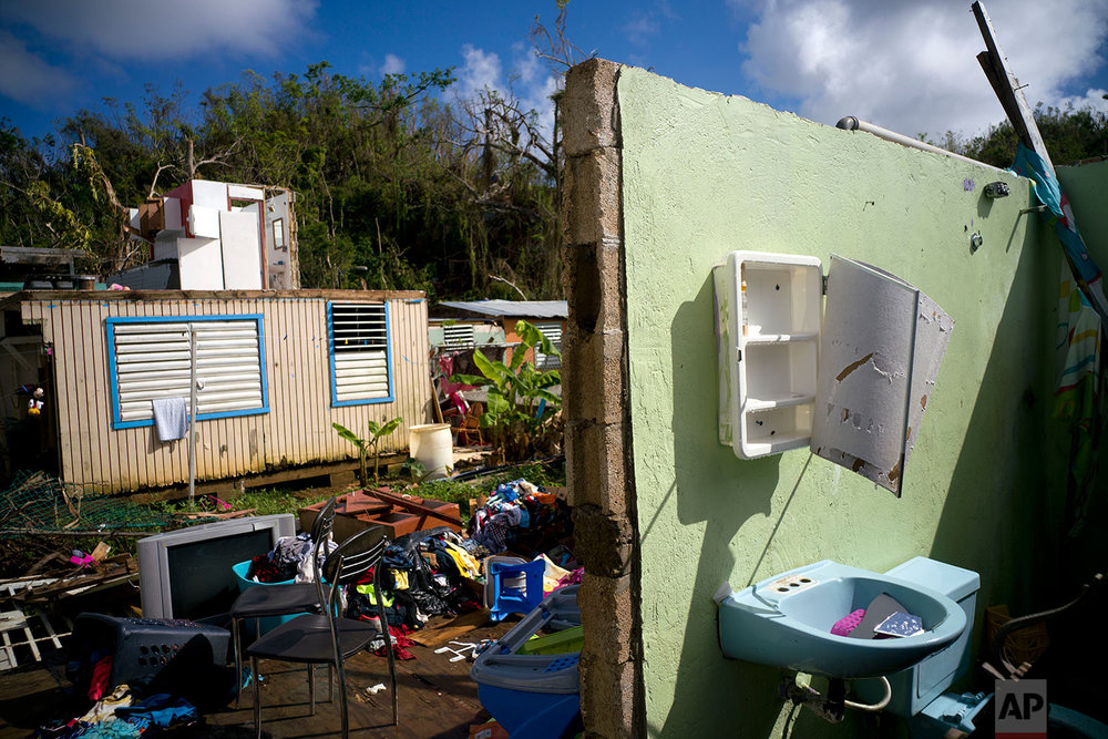 In this Saturday, Oct. 14, 2017 photo, what was once the home Arden Dragoni and his family lays in ruins after the passing of Hurricane Maria in Toa Baja, Puerto Rico. (AP Photo/Ramon Espinosa)
