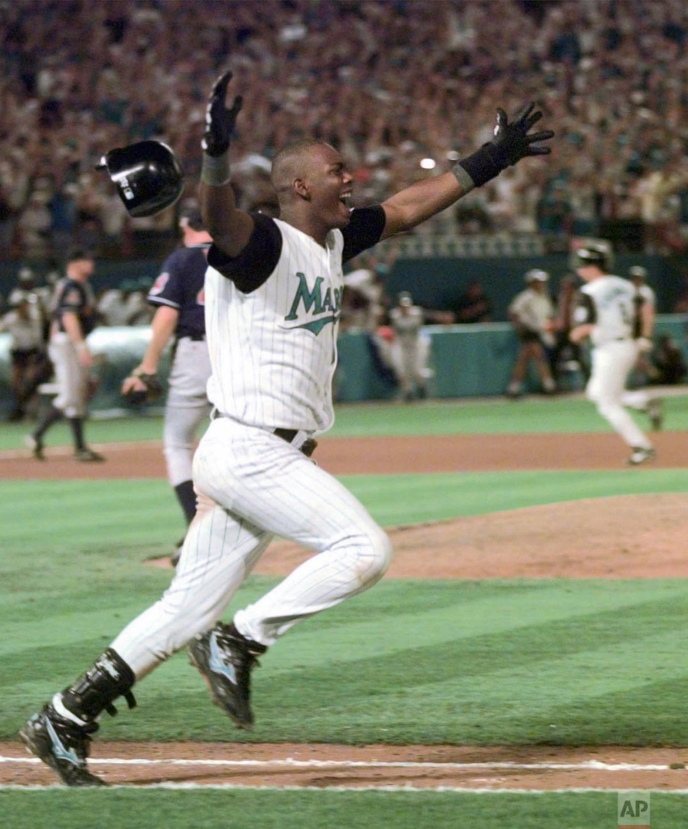 Florida Marlins Edgar Renteria runs down the first base line as his single scores Craig Counsell to win Game 7 and the World Series early Monday morning, Oct. 27, 1997, at Miami's Pro Player Stadium. The Marlins defeated the Cleveland Indians 3-2. (AP Photo/Hans Deryk)