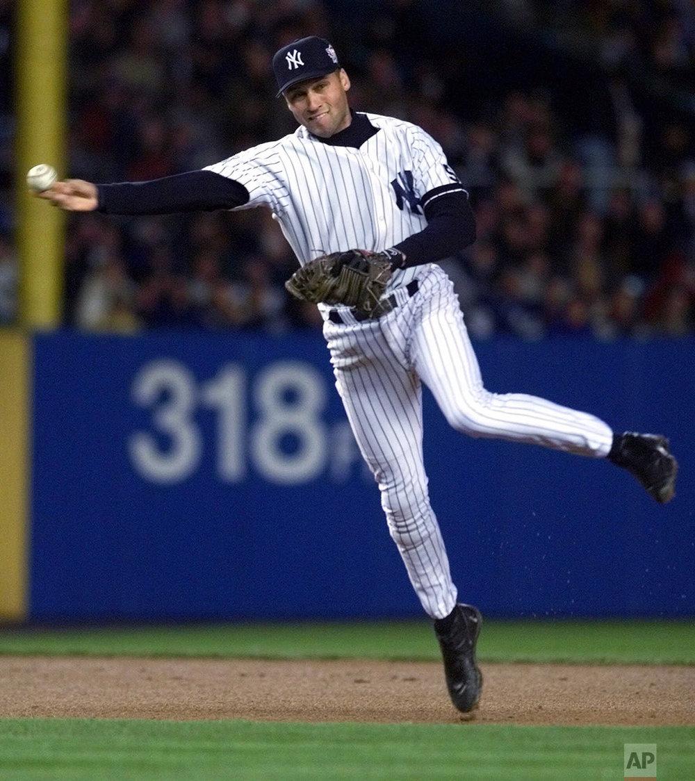 New York Yankees shortstop Derek Jeter throws out Atlanta Braves Andruw Jones in the third inning of game 4 of the World Series in New York, Wednesday, Oct. 27, 1999. (AP Photo/Eric Draper)