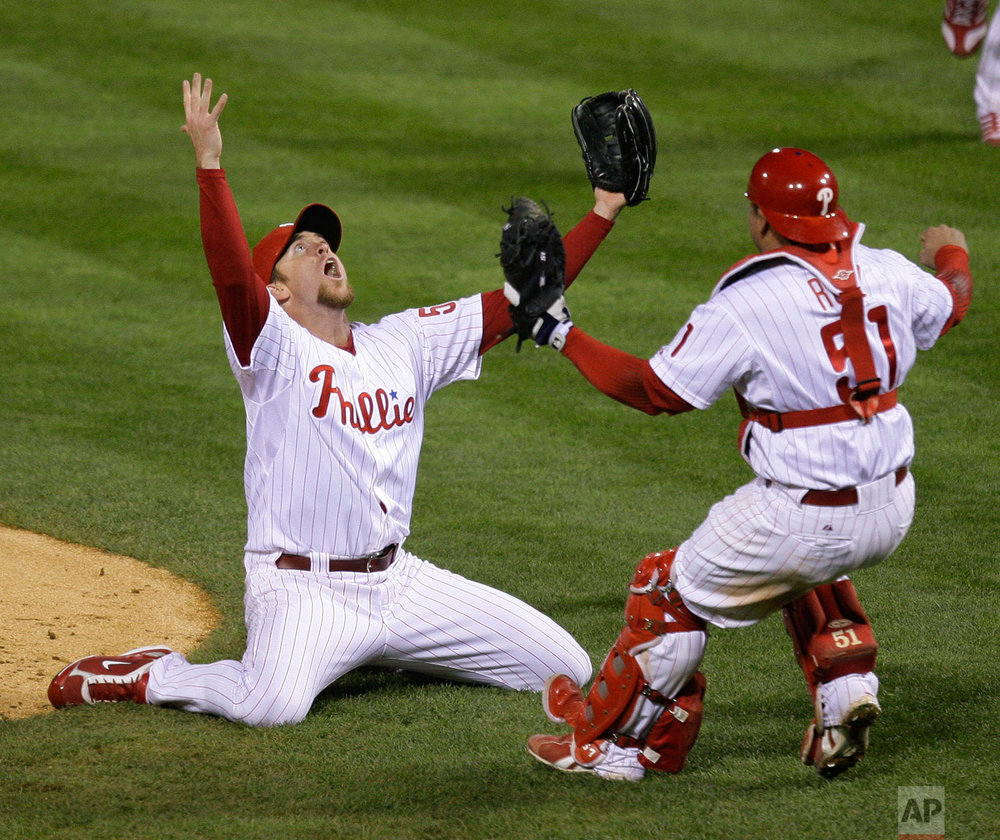 Philadelphia Phillies' Brad Lidge, left, and Carlos Ruiz react after their victory in Game 5 of the baseball World Series in Philadelphia, Wednesday, Oct. 29, 2008. The Phillies defeated the Tampa Bay Rays 4-3 to win the series.  (AP Photo/Julie Jacobson)