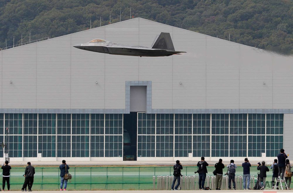 A U.S. F-22 stealth fighter takes off during the press day of the 2017 Seoul International Aerospace and Defense Exhibition at Seoul Airport in Seongnam, South Korea, Monday, Oct. 16, 2017. (AP Photo/Ahn Young-joon)
