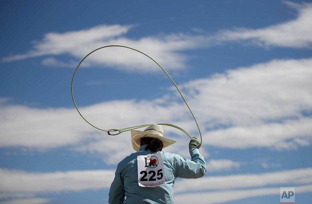 In this Sept. 23, 2017, photo, Carla Bryant warms up before competing in the mounted break-away roping event at the Bighorn Rodeo in Las Vegas. (AP Photo/John Locher)